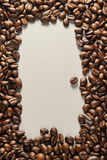 Coffebeans on Neutral Gray Background. Dark Roast Coffee. Dark Roast Coffee on neutral Background Stock Image