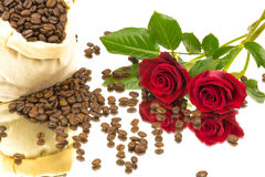 Coffebeans roses mirror. A bag coffeebeans and roses on a mirror Stock Photos