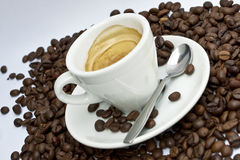 Coffee 02. Cup of coffee sitting in a bed of coffee beans Royalty Free Stock Photography