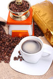 Coffee. Cup, beans and grinder Royalty Free Stock Photos