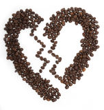 Coffee. Broken heart drawn from the seeds of coffee on a white background royalty free stock images