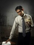 Coffee. Business man holding laptop and coffee royalty free stock images