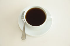 Coffee. A cup of coffee against a white background Royalty Free Stock Photo