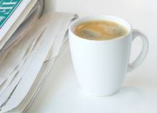 Coffee. And morning paper against a white background stock photos