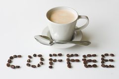 Coffee. With  beans spelling out '' ona white background royalty free stock images