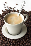 Coffee. With  beans as a background royalty free stock image