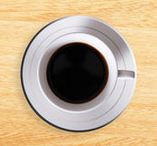 Coffee. High view of coffee cup over wooden surface Stock Photos