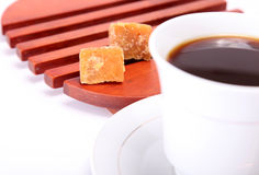 Coffee. Cup of coffee with two lumps of sugar in a wooden tray Stock Images