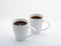 Coffee. Two cups of coffee on a white background Royalty Free Stock Photos