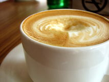 Coffee. Close up photo of capuccino/flat white coffee with froth on top in cafe Royalty Free Stock Photography