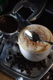 Coffee. With cinnamon powder serve in hot Stock Photo