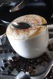 Coffee. With foam and cinnamon Stock Photo