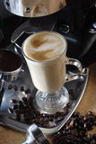 Coffee. Hot latte with coffee machine Royalty Free Stock Photo