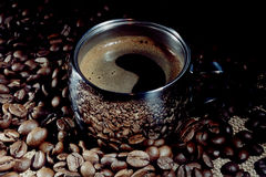 Coffee. Cup of coffee with froth and corns. Reflection of coffee grains in the cup Stock Photos