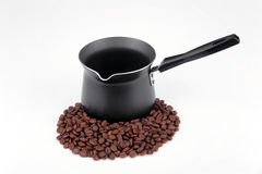 Coffee. Pot and  grains on a white background Royalty Free Stock Photos