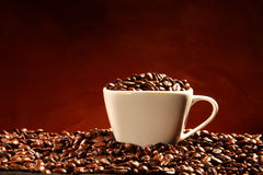 Coffee. The coffee cup and coffee beans Royalty Free Stock Photos