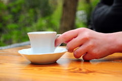 Coffee. A hand holds a cup of coffee Stock Photos