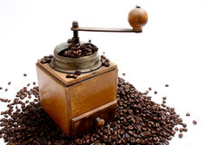 Coffee. Beans and an oldfashioned  mill Royalty Free Stock Image