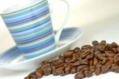 Coffee. Pile of coffee beans close to coffee cup Stock Photo