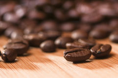 Coffee. Roasted coffee beans on a bamboo board Stock Images
