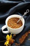 Coffee. Instant coffee in a white cup on black silk Royalty Free Stock Photography
