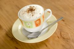 Coffee. Cup of cappucino on the table close up stock images