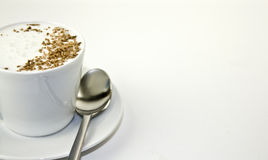 Coffee. Frothy coffee cup and saucer with copy space Royalty Free Stock Photo