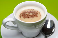 Coffee. Cup of Cappucino coffee in white cup and saucer Royalty Free Stock Photography