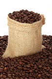 Coffee. Beans in burlap sack Stock Images