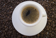 Coffee. In a white cup, fried grains of Royalty Free Stock Photography