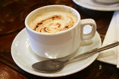 Coffee. A frothy cup of cappuccino served stock image