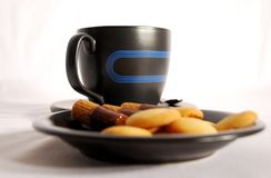 Coffee. Black coffee cup with cookies over white background Royalty Free Stock Photography