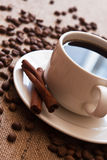 Coffee. Cup of coffee and coffee beans on sacking material Stock Photo