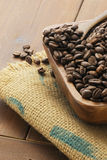 Coffee. Beans in wooden bowl Stock Images