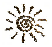 Coffee. Sun symbol from coffee beans on a white background Stock Images