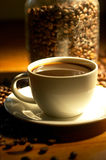 Coffee. Cup of coffee with bean background Stock Photography