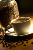 Coffee. Cup of coffee in warm lighting Royalty Free Stock Photography