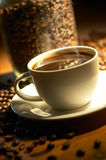 Coffee. Cup of coffee in warm lighting Stock Photography