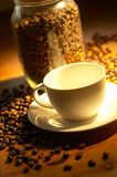 Coffee. Empty cup of coffee in warm lighting Royalty Free Stock Images
