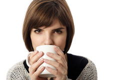 Coffee. Stock photo of a young woman drinking coffee or tea Stock Photos