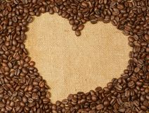 Coffee. Beans heart on burlap royalty free stock photography