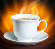 Coffee. Cup of hot coffee on dark background Royalty Free Stock Image
