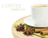 Coffee. Closeup shot of freshly prepared cup of coffee with cinnamon and star anise over white (with sample text royalty free stock photos