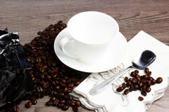 Coffee. Cuo of coffee on wooden table Stock Images