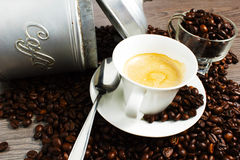 Coffee. Cuo of coffee on wooden table with coffeee beans Stock Images