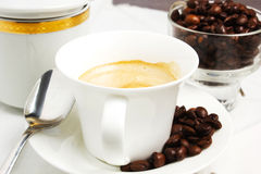 Coffee. Cuo of coffee on wooden table with coffeee beans Royalty Free Stock Image