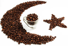 Coffee. Cuo of coffee with composition of coffeee beans on the white background Royalty Free Stock Images