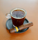 Coffee. Black hot coffee and cigar royalty free stock photography