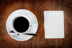 Coffee. Hot coffee with note paper on wood table Royalty Free Stock Photography