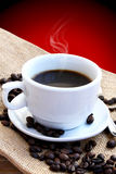 Coffee. Cup of coffee with coffe beans near stock photography